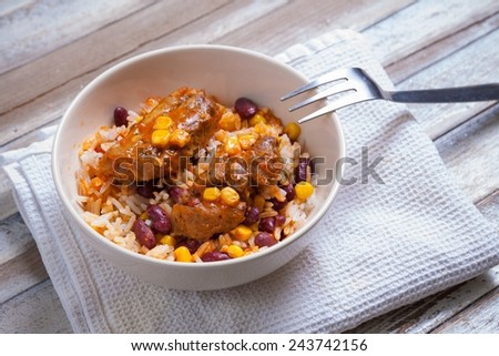 Mexican chicken nuggets with rice - stock photo