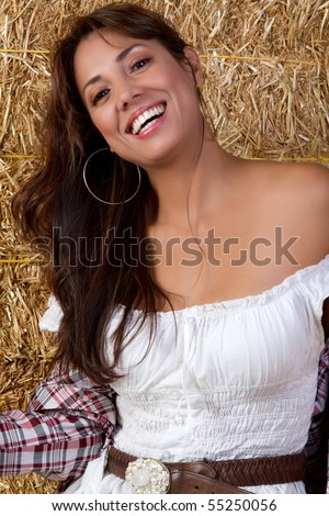Mexican country girl in hay - stock photo