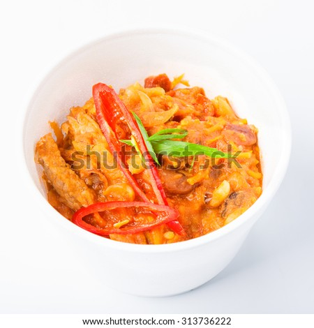 Mexican cuisine food delivery - chili con carne in white plastic plate closeup isolated at white background in plastic plate - stock photo