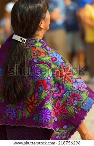 Mexican Dress - Zinacantan Chiapas Mexico / Mexican woman with multicolored dress with floral texture - Zinacantan Chiapas Mexico - stock photo