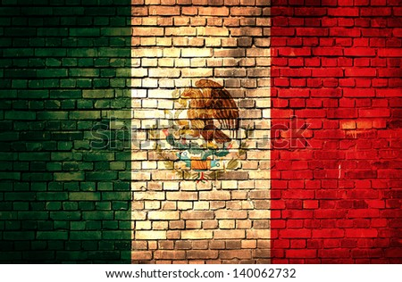 Mexican flag on brick wall - stock photo