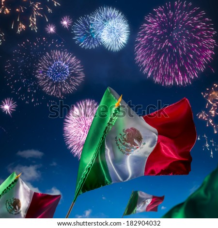 Mexican Flags with fireworks, Independence day, cinco de mayo celebration - stock photo