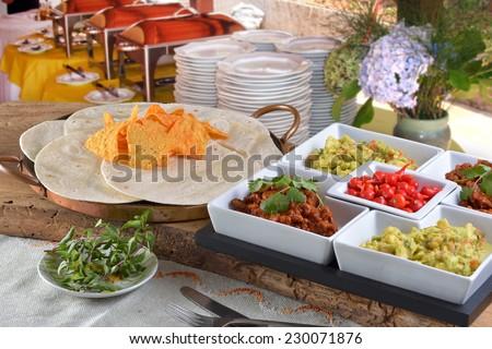 Mexican food - chilli, guacamole, tortillas and nachos - stock photo