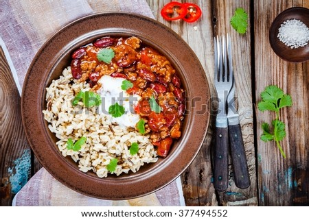 Mexican food: homemade chili with beans and wild rice - stock photo