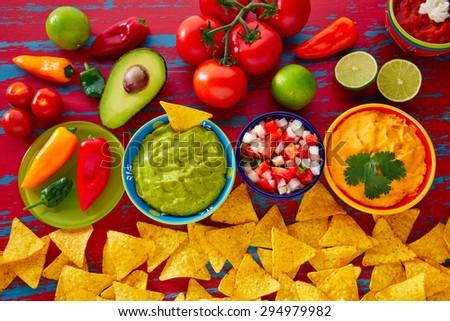 Mexican food nachos guacamole pico de gallo and dipping cheddar cheese - stock photo