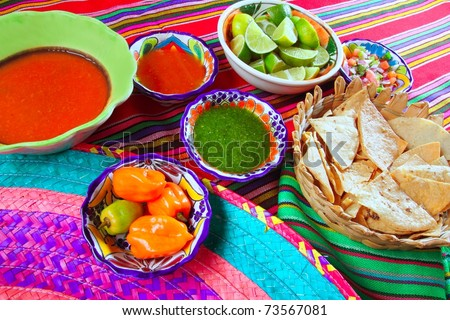 Mexican food varied chili sauces nachos lemon Mexico flavor - stock photo