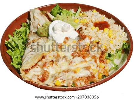 Mexican food with avocado, cheese, rice  and green salad served in traditional plate with tortillas - stock photo