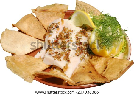 Mexican food with honey served in traditional plate with tortillas - stock photo