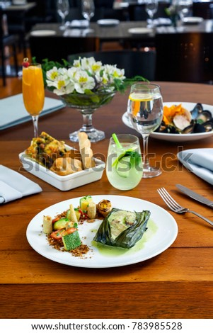 Mexican gourmet table setting with chicken tamale mussels and cocktails & Mexican Gourmet Table Setting Chicken Tamale Stock Photo (Royalty ...