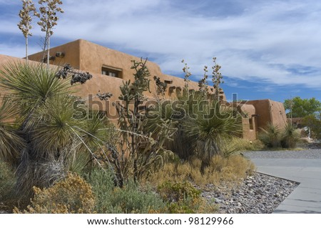 Mexican hacienda behind the cactus in New Mexico, USA - stock photo
