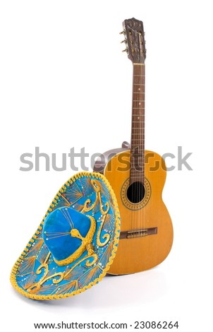 Mexican Hat and a Wood Guitar on white . - stock photo