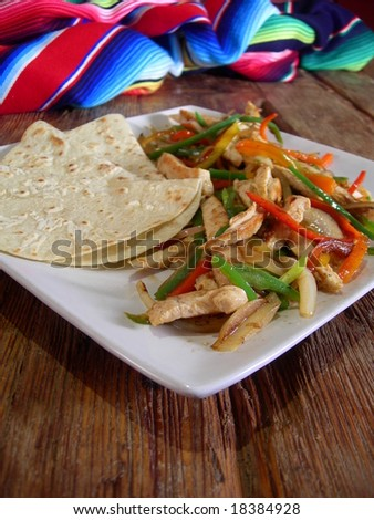 Mexican hot chicken fajitas, in a mexican restaurant. - stock photo