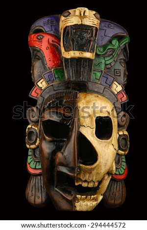 Mexican Mayan Aztec ceramic painted mask with skull isolated on black - stock photo
