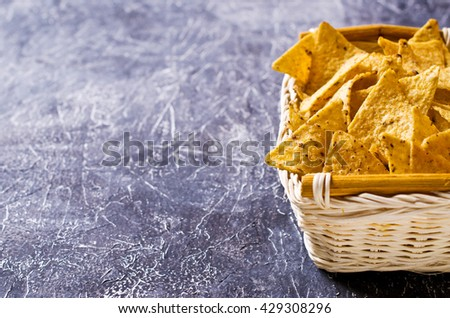 Mexican nachos chips of triangular shape. Selective focus. - stock photo