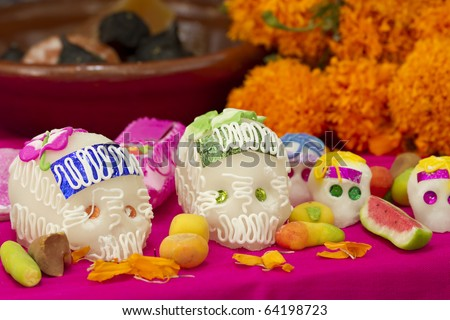 Mexican offering for the dead showing sugar skulls and assorted traditional candy. Holiday Dia de los Muertos. - stock photo