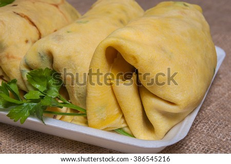 Mexican pancakes stuffed with meat, cheese and vegetables. - stock photo