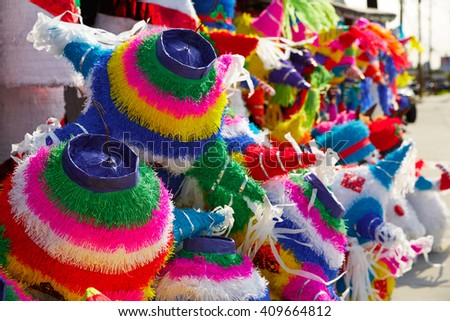 Mexican party pinatas decorated with fringed tissue colorful paper - stock photo