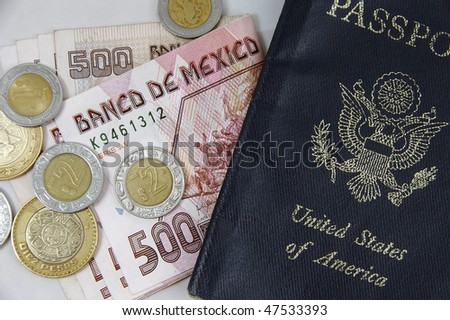 Mexican pesos and US passport - stock photo