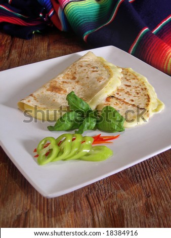 Mexican quesadillas with jalapenos and basil, in a mexican restaurant. - stock photo