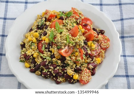 Mexican Quinoa Salad with tomatoes, corn and beans - stock photo