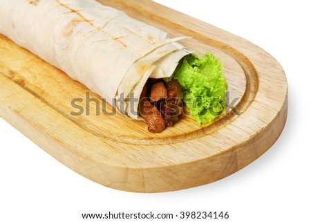 Mexican restaurant fast food - wrapped burritos with  pork, mushrooms and vegetables closeup at wooden desk on table. Mexican burrito at wood desk isolated at white background