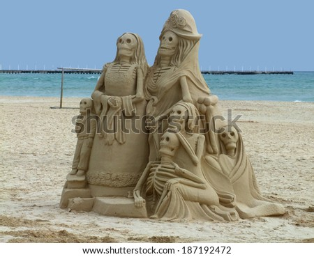 mexican skeleton sculptures made of sand at the Playa delCarmen in Mexico - stock photo