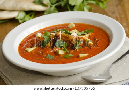 Mexican soup with chicken, avocado and coriander