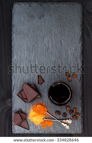 Mexican spicy hot chocolate with chili pepper and cinnamon. Top view from above, free text copy space background - stock photo