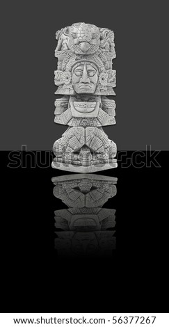 Mexican statue, isolated against dark background (incl. clipping path)