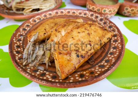 Mexican street food quesedilla served on traditional plate - stock photo