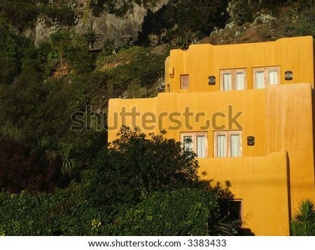 Mexican style house in terracotta color - stock photo