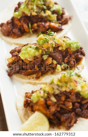 Mexican style Tacos al Pastor served on soft tortillas - stock photo