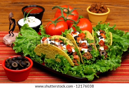 Mexican taco dinner set up with condiments. - stock photo