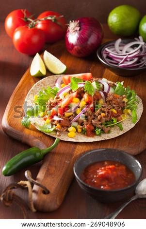 mexican taco with beef tomato salsa onion corn - stock photo