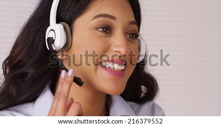 Mexican telemarketer talking with headset - stock photo