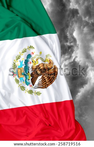 Mexican waving flag on a bad day - stock photo
