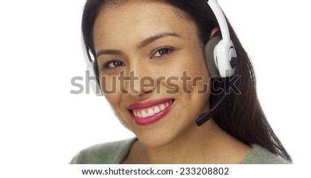 Mexican woman telemarketer smiling - stock photo