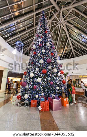 MEXICO, CANCUN - DECEMBER 31, 2014: Shopping Mall Plaza Las Americas in Cancun city. New Year shopping at last day of December. Great beautiful Christmas tree in center of Plaza Las Americas. - stock photo