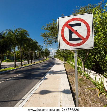 MEXICO, CANCUN - 5 MARCH 2015: No parking sign on caribbean street road