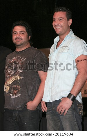 MEXICO CITY - APRIL 6: (L-R) Iguana and Javier pose for photographers at Festival Music for the Earth Music Fest press conference at El Lunario Concert Hall April 6, 2009 in Mexico City, Mexico. - stock photo