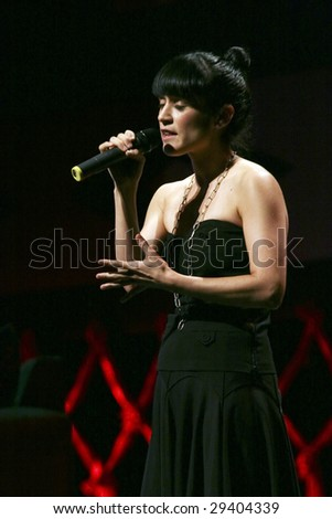 MEXICO CITY - APRIL 21 : Singer Julieta Venegas performs during The Chavela Vargas 90th Anniversary homage at the Teatro de La Ciudad de Mexico on April 21, 2009 in Mexico City, Mexico. - stock photo