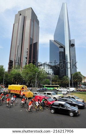 MEXICO CITY - FEB 24: Traffic on the Reforma Avenue in Mexico City, Mexico.It's a major tourist attractions, filled with luxurious restaurants, hotels, office buildings and public art exhibitions - stock photo