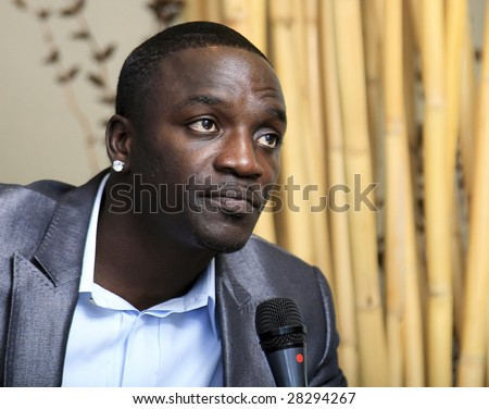 "MEXICO CITY - MARCH 31: Singer-Producer Akon promotes his album ""Freedom"" at the Great Room Hotel W in Mexico City March 31 2009. The Singer Poses to photographers for photoshoots and offer interviews. - stock photo"
