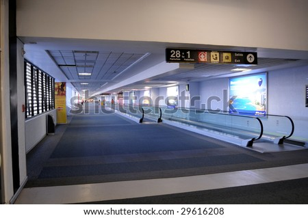 MEXICO CITY - MAY 1: Hallways of the Benito Juarez Airport in Mexico City are nearly deserted on May 1, 2009 in Mexico City. H1N1 swine flu scare has diminished tourism and flights to Mexico. - stock photo