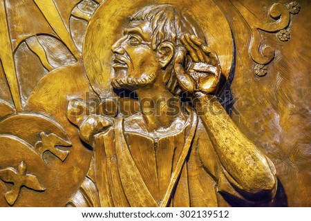 MEXICO CITY, MEXICO-DECEMBER 25, 2015 Bronze Relief Juan Diego Mexican peasant 1500s receiving revelation Virgin Mary, Guadalupe Shrine, Mexico City Mexico  Virgin Mary left her image on his cloak. - stock photo