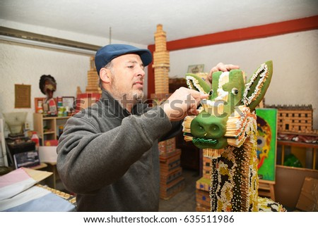 MEXICO CITY, MEXICO - FEBRUARY 15 2017: Artist Alex Lerner finishing a sculpture made out of matches in Mexico city February 15,2017.He specializes in doing historical building of Mexico with matches