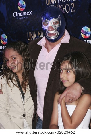 "MEXICO CITY, MEXICO-JUNE 9 : Wrestler Blue Demon (C) attends the ""Night at the Museum 2: Battle of the Smithsonian"" Mexico City Red Carpet Premier at Cinemex Antara at Mexico,City.,Mexico. June 9 2009 - stock photo"