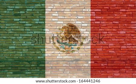 Mexico flag on texture brick wall.  - stock photo