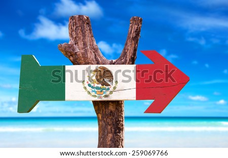 Mexico Flag wooden sign with a beach on background - stock photo