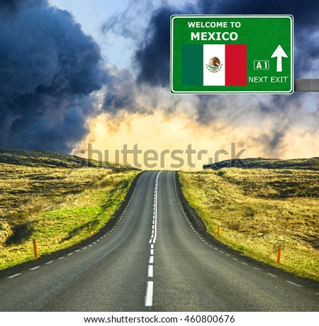 Mexico road sign against clear blue sky - stock photo